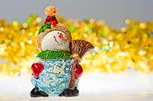 stock photo of figurines  - figurine snowman and tinsel  - JPG