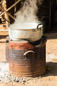 pic of boiling water  - boiling water in traditional old pot on charcoal stove brazier - JPG