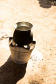 stock photo of brazier  - blurry defocused traditional old pot on charcoal stove brazier for background - JPG