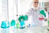picture of reagent  - Scientist taking a vial with reagent for his research, selective focus ** Note: Soft Focus at 100%, best at smaller sizes - JPG