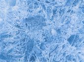 image of ice crystal  - beautiful crystal patterns on the surface of the clear blue brittle ice on the lake in winter - JPG