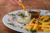 pic of high calorie foods  - French fries on a plate with different spices - JPG