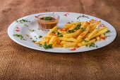 stock photo of high calorie foods  - French fries on a plate with different spices - JPG