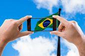 image of brasilia  - Hand holding smartphone in Brasilia - JPG