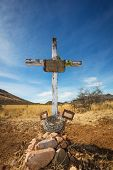 stock photo of crucifix  - Old shallow stone grave with crucifix and blank frames - JPG