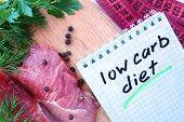 image of meats  - Notepad with low carb diet and fresh meat  on wooden board - JPG