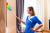 pic of maids  - Image of happy maid dusting in hotel room - JPG