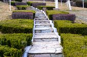 image of stepping stones  - Old stone stairs step in the garden