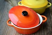 stock photo of pot roast  - Two little colorful cooking pots for julienne - JPG