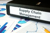 stock photo of supply chain  - Graphs and file folder with label supply chain managment - JPG
