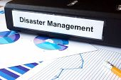 image of disaster preparedness  - Graphs and file folder with label  Disaster Management - JPG