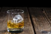 stock photo of malt  - Single Malt Whiskey with Ice Cubes on wooden background - JPG
