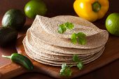 stock photo of whole-wheat  - whole wheat tortillas on wooden board and vegetables - JPG