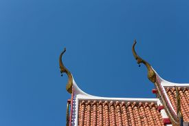 picture of gable-roof  - the gable apex with small bell on the roof of temple - JPG