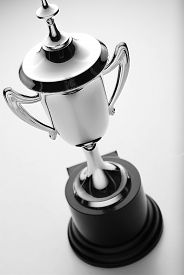 image of trophy  - Silver trophy cup high angle view over a grey background to be awarded to the winner or second placed contestant in a competition or championship - JPG