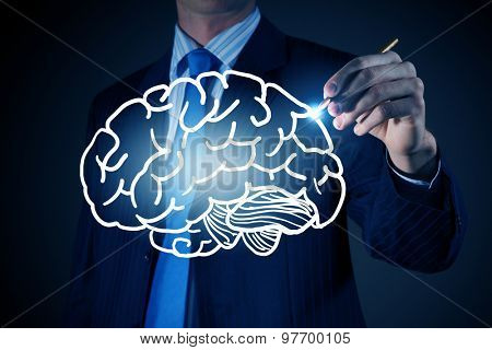 Chest view of businessman drawing human brain on screen