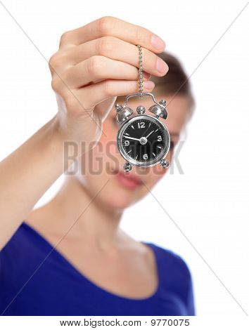 Beautiful Woman Holding A Small Alarm Clock In Her Hand