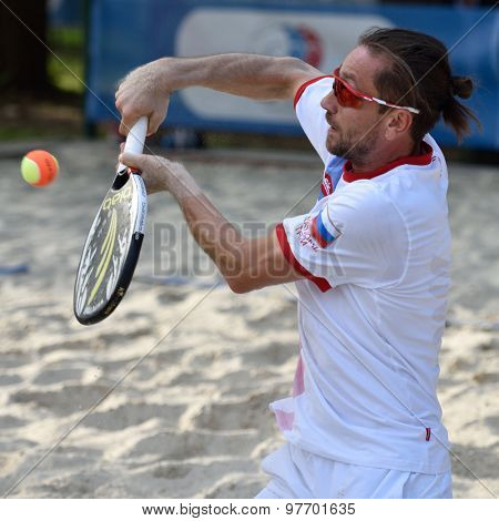 MOSCOW, RUSSIA - JULY 17, 2015: Sergey Kuptsov of Russia in the quarterfinal match of the Beach Tennis World Team Championship against Japan. Russia won the match 3-0