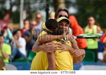 MOSCOW, RUSSIA - JULY 17, 2015: Team Brazil celebrates the victory in the quarterfinal match of the Beach Tennis World Team Championship against France. Brazil won the match 2-1