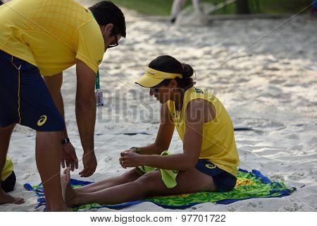 MOSCOW, RUSSIA - JULY 17, 2015: Team captain Gui Prata helps to Joana Cortez of Brazil during the ITF Beach Tennis World Team Championship. 28 nations compete in the event this year