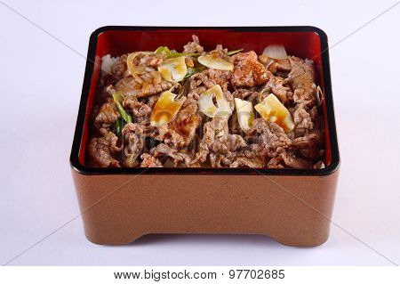Gyudon - Japanese Beef Bowl Isolated On White Background, Stir Japanese Beef With Sweet Sauce On Ric