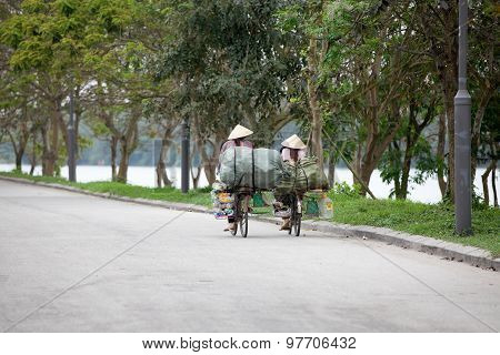 Two vietnamese women riding the bicycle