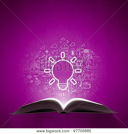 Old opened book with business sketches over purple background