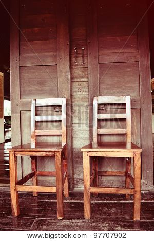 Double wooden chairs on wood house thai retro style