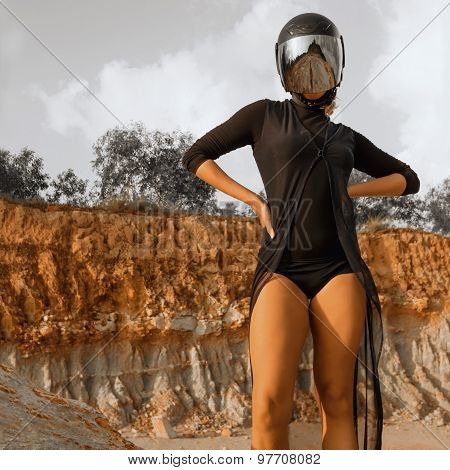 Biker Girl In Hemlet Standing In Desert Land