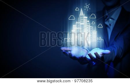 Chest view of businesswoman holding digital construction project in palms