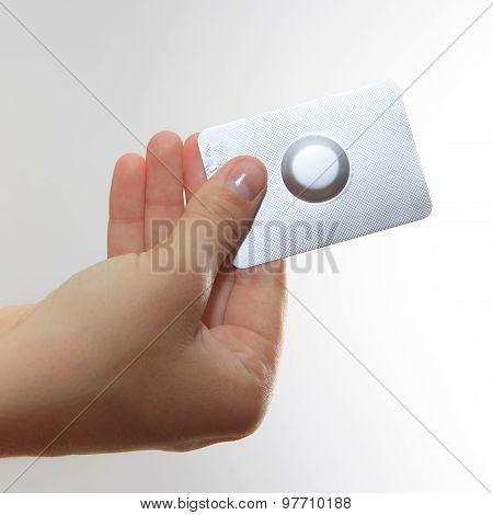 Female Hand Hold One Medical Pill In Blister Pack