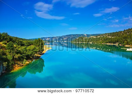 Verdon Canyon - the most spectacular in the French Alps. Spring Provence. Azure water reflects the clouds