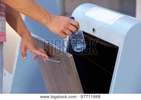 Man Hand Throwing Away Plastic Bottle In Recycling Bin
