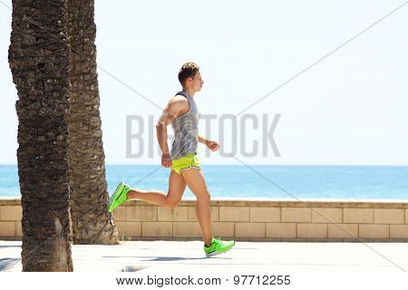 Fitness Man Running By The Sea Side
