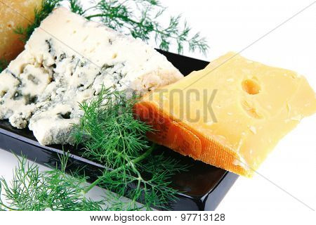 different type of aged cheeses on black porcelain plate