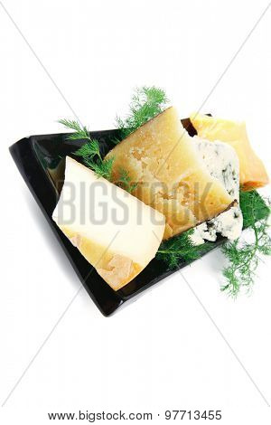 soft delicatessen cheeses on black porcelain plate