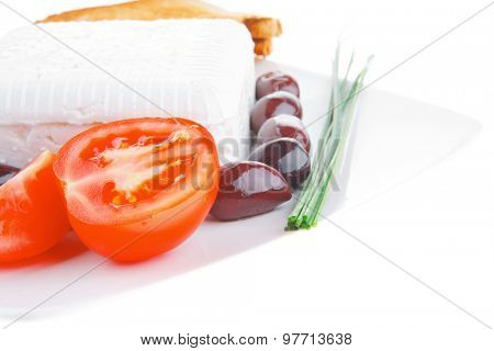 image of soft feta and vegetables on white