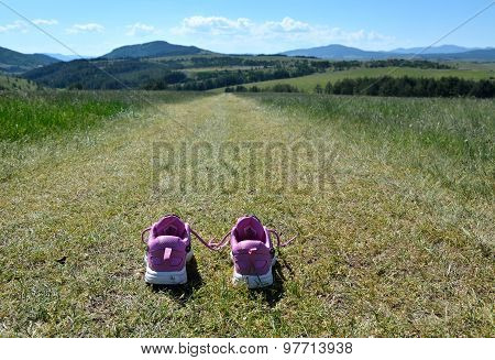 Sneakers On Mountain Road