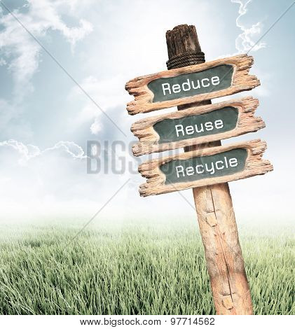 Wooden Sign With Reduce, Reuse And Recycle Wording Ecology Concept.