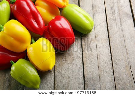 Colorful peppers on rustic wooden background