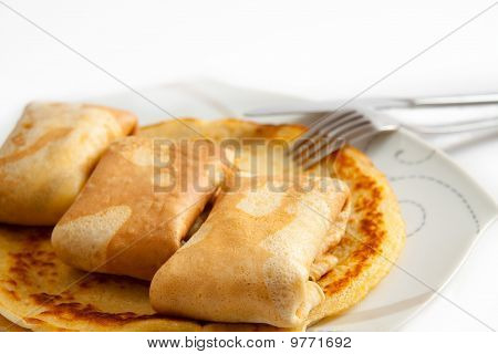 Pancakes With Filling On Plate with knife and fork