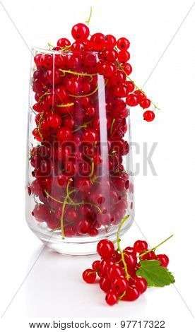 Fresh red currants in glass isolated on white
