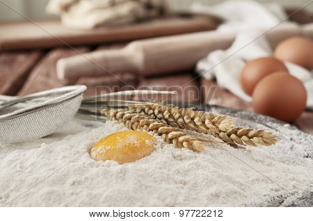 Egg Yolk In Flour Close Up On A Wooden Table In A Bakery