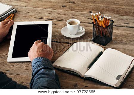 Men Hand Clicks On The Tablet Screen