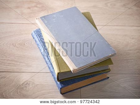 Old books on wooden background