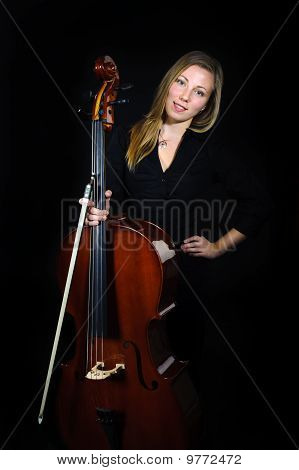 Young Cellist Standing On Black Background