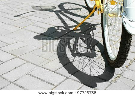 Bicycle over pavement background