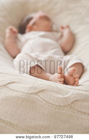 leg sleeping newborn