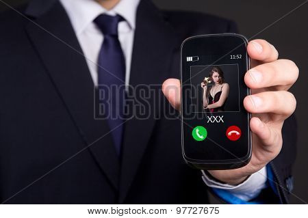 Infidelity Concept - Male Hand Holding Smart Phone With Incoming Call From Mistress