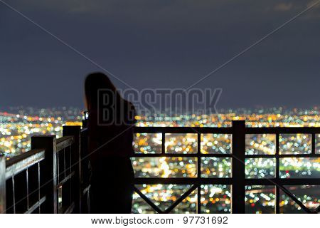 Defocused Girl And City Light From Viewpoint